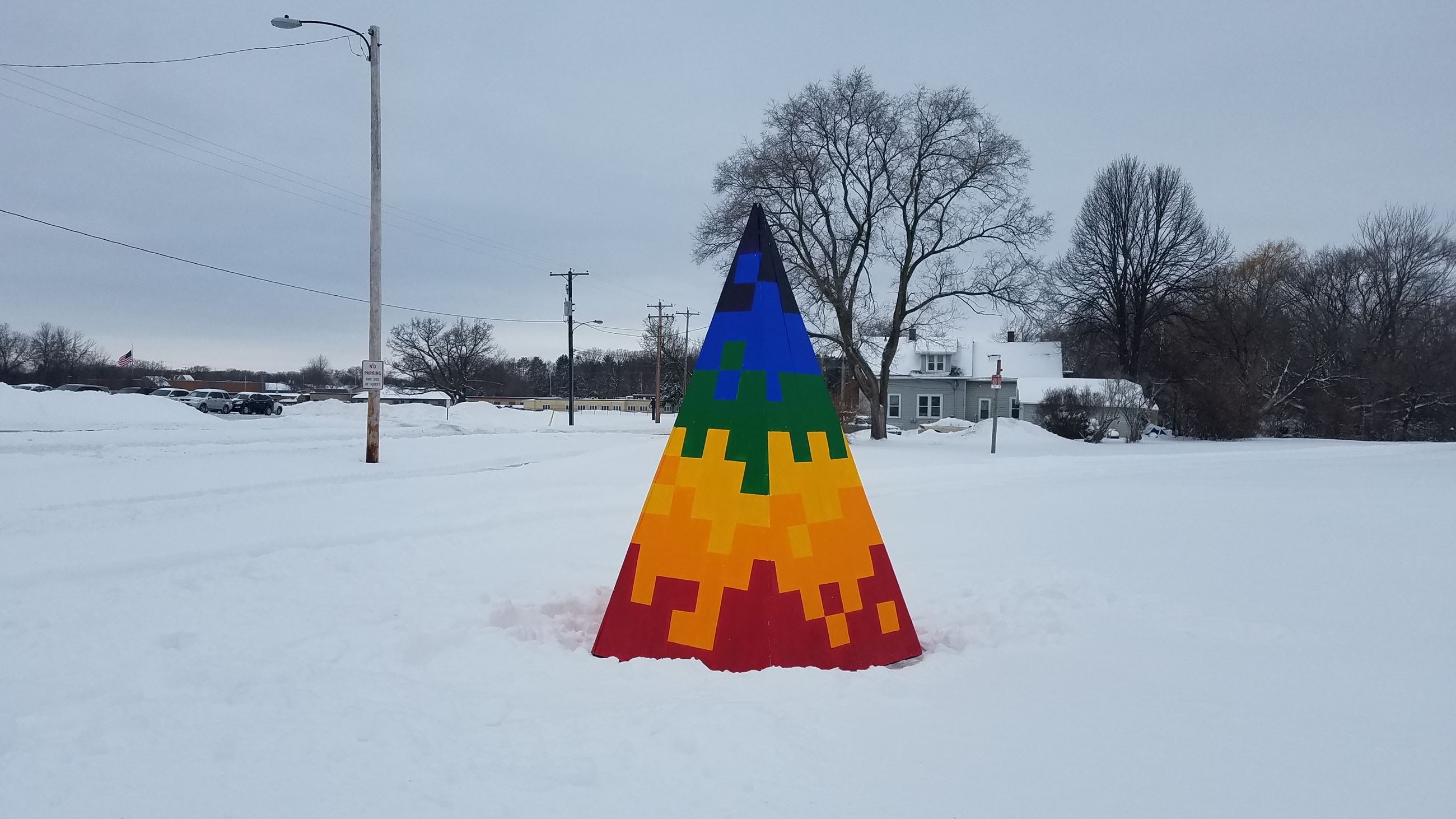 Rainbow pyramid sculpture located at Fisk and Dousman, created by Malachi Duffey.